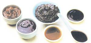 Cockwise from top left yellow bean sauce, black been sauce, oyster sauce, dark soy sauce, light soy sauce and hoisin sauce