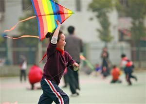 A child going to fly a kite happily